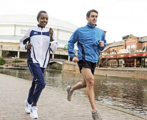 Ронни на пробежке с трехкратной олимпийской чемпионкой Тирунеш Дибабой